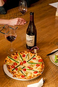 Chef Kim Mahan's pizzas are crowd pleasers at Burnt Bridge in downtown Vancouver, Wash.