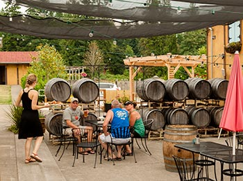 Food service at Rusty Grape includes wood-fired pizza and wine by the glass or bottle