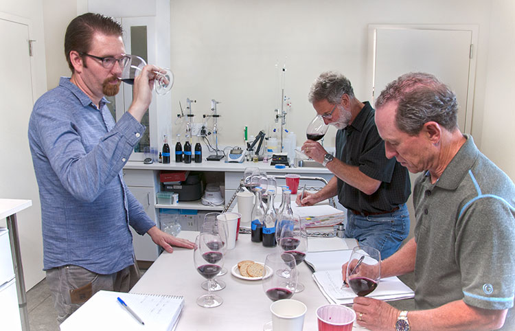 Left to right: Winemaker Louis Skinner conducts lab trials with consulting winemaker Bob Betz and owner Steve Griessel