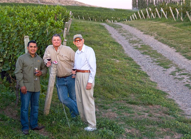 Winemaker Jose Mendoza (left) and director of winemaking Greg Powers standing with his father and winery founder, Bill Powers, a revered pioneer of Washington's wine industry